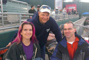 Mike (Carney's Owner) at the Lugnuts game celebrating Carney's 10th anniversary with his bookkeeper, Stacy & her husband Kevin.